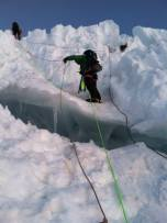 Running a belay over the ice
