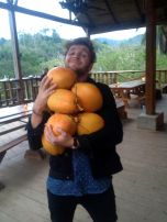 Carlo has no bags, he travels with an armload of fresh coconuts